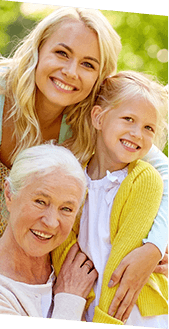 Smiling mother, daughter, and granddaughter