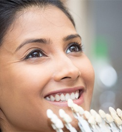 A young woman trying porcelain veneers